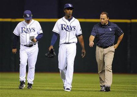 Tampa Bay Rays' Maddon, Upton and Porterfield walk during their MLB baseball game against Detroit Tigers in St. Petersburg