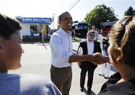 President Obama greets locals after buying ice cream during a bus tour in DeWitt, Iowa