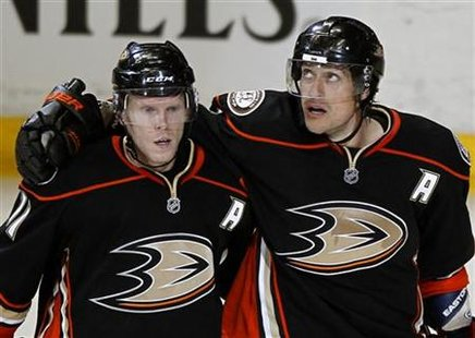 Anaheim Ducks right wing Selanne celebrates his goal against the Nashville Predators with teammate Koivu during Game 1 of the NHL Western Co