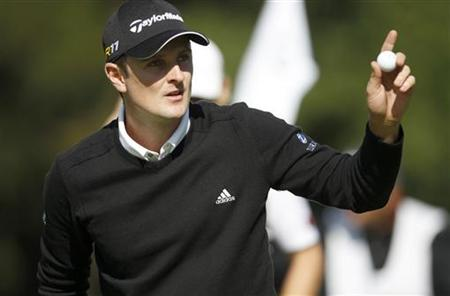Britain's Justin Rose waves to the crowd after making birdie on the ninth hole during the first round of the PGA TOUR FedExCup BMW Champions