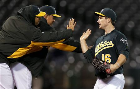 Athletics' Willingham celebrates after winning their MLB American League baseball game against the Tigers in Oakland
