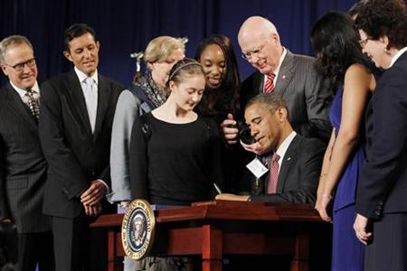 U.S. President Barack Obama signs the American Invents Act at Thomas Jefferson High School in Virginia