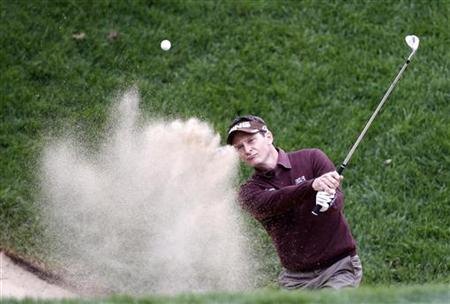 Mark Wilson of the U.S. hits out of the sand trap during PGA Tour FedExCup BMW Championship golf tournament in Lemont