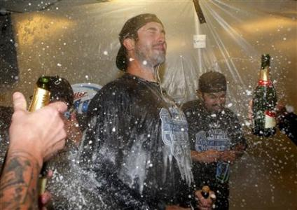Detroit Tigers pitcher Justin Verlander celebrates in the visitor clubhouse after the Detroit Tigers clinched the American League Central Division after defeating the Oakland Athletics in Oakland, Credit: REUTERS/Beck Diefenbach