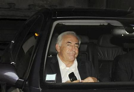 Former IMF chief Dominique Strauss-Kahn leaves his apartment, hours after being questioned by police, in Paris