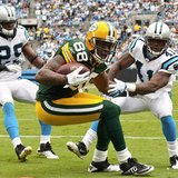 Green Bay Packers tight end Jermichael Finley catches a pass in the endzone against Carolina Panthers cornerback Captain Munnerlyn during NF