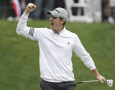 Justin Rose of Britain celebrates winning the PGA Tour FedExCup BMW Championship golf tournament in Lemont
