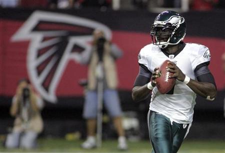 Eagles quarterback Vick looks to throw in his return to play the Atlanta Falcons as the starter for the Eagles, in the first half of their N