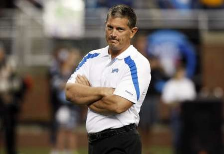Detroit Lions head coach Jim Schwartz watches his team do pre-game warm-up before their NFL season home opener football game against the Kansas City Chiefs in Detroit, Michigan September 18, 2011. REUTERS/Rebecca Cook (UNITED SATES - Tags: SPORT FOOTBALL)