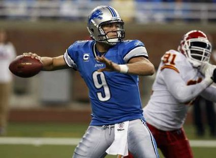 Detroit Lions quarterback Mathew Stafford looks for his receiver during the first half of their NFL season home opener football game against the Kansas City Chiefs in Detroit, Michigan September 18, 2011. REUTERS/Rebecca Cook (UNITED SATES - Tags: SPORT FOOTBALL)