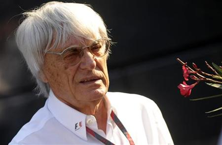 Formula One commercial supremo Ecclestone walks in paddock after second free practice session for the Italian F1 Grand Prix at the Monza cir