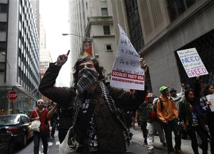 Protesters demonstrate near Wall Street against banks and corporations in New York