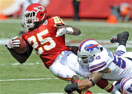 Chiefs' Charles is brought down by Bills' Barnett in Kansas City, Missouri