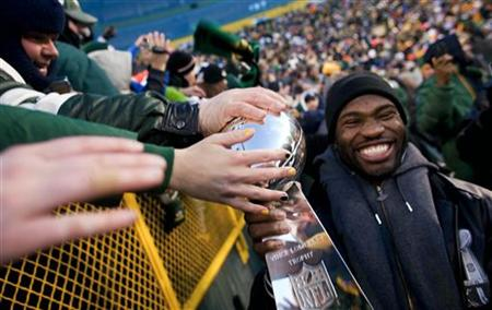 "NFL Super Bowl Champions Green Bay Packers' Nick Collins carries the Super Bowl Trophy on a victory lap during the ""Return To TitleTown Cele"