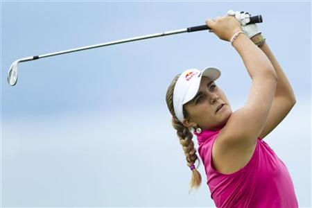 Thompson of the U.S. hits her second shot on the 5th hole during the third round of the Evian Masters golf tournament