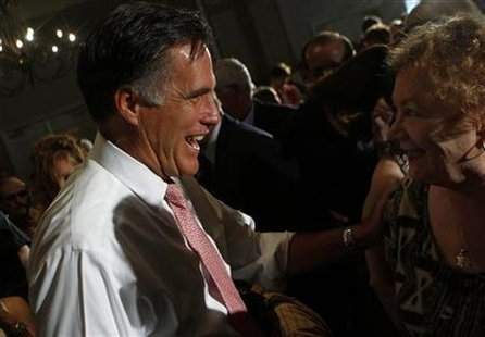 Republican presidential candidate and former Massachusetts Governor Mitt Romney greats a woman during a town hall meeting in Sun Lakes, Ariz