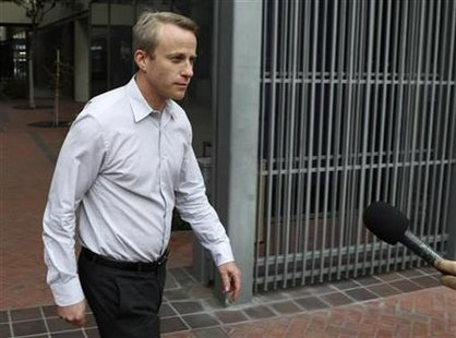 Fleishman walks out of the Robert Peckman United States Courthouse after appearing in federal court on insider trading charges in San Jose