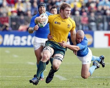 Italy's Fabio Semenzato tackles Australia Wallabies' David Pocock during their Rugby World Cup Pool C match at North Harbour Stadium in Auck