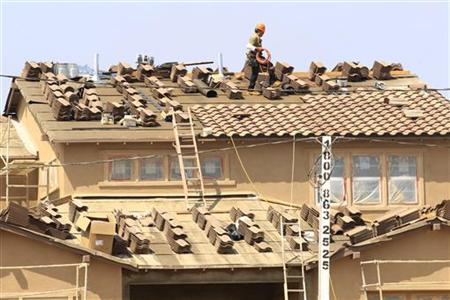 A worker lays shingles as construction continues on a residential home in Carlsbad