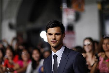 "Lautner poses during the world premiere of ""Abduction"" in Hollywood"