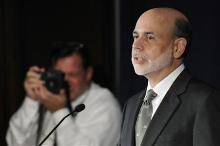 Bernanke is photographed as he makes remarks at the start of a conference on systemic risk, at the Federal Reserve in Washington
