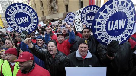 United Auto Workers convention delegates chant during a rally for good jobs and tax reform following a UAW convention in Detroit, Michigan,
