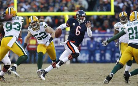 Chicago Bears quarterback Jay Cutler (6) scrambles through Green Bay Packers linebacker Erik Walden, linebacker Clay Matthews and cornerback