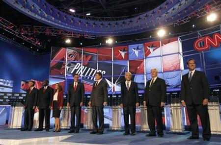 Republican presidential hopefuls take the stage prior to the CNN/Tea Party Republican presidential candidates debate in Tampa