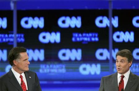 Romney and Perry participate in the CNN/Tea Party Republican presidential candidates debate in Tampa