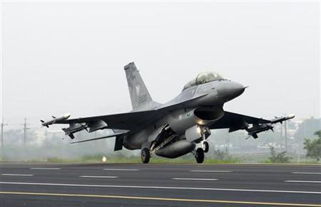 A F-16 fighter jet lands on a highway used as an emergency landing strip during the Han Kuang military exercise in Madou