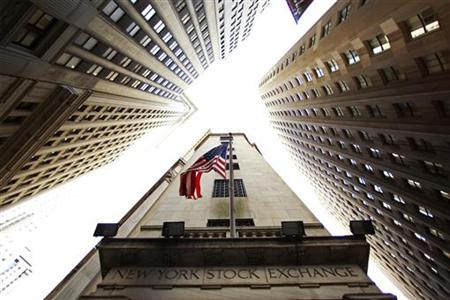 A flag flies outside the door of the New York Stock Exchange in New York