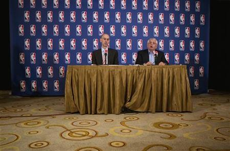 National Basketball Association commissioner David Stern answers questions with deputy commissioner, Adam Silver, regarding failed contract