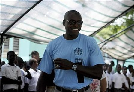 U.S. Olympic gold medalist Lewis arrives at a school in Port-au-Prince