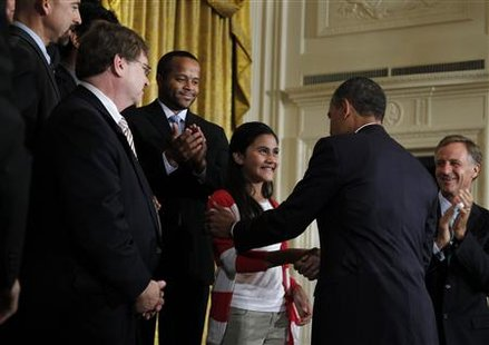 President Barack Obama greets Keiry Herrera at a No Child Left Behind event in Washington