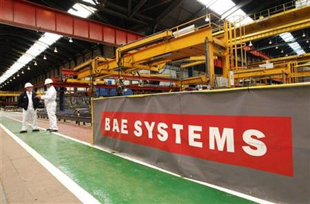 Workmen stand in the BAE Systems' Govan shipyard in Glasgow, Scotland