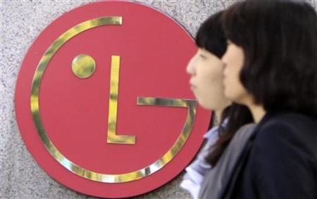 People walk past a company logo of LG Electronics in Seoul