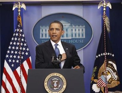 President Barack Obama holds a news conference in the briefing room of the White House in Washington