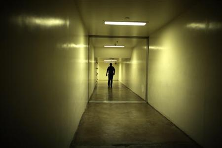 A sheriff's deputy walks down a hallway at the Orange County jail in Santa Ana