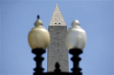 The west-facing side of the Washington Monument is photographed the day after an earthquake shook the east coast