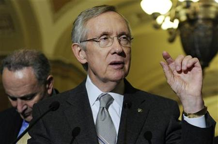 Reid talks to reporters about the senate's vote on debt ceiling legislation at the U.S. Capitol in Washington