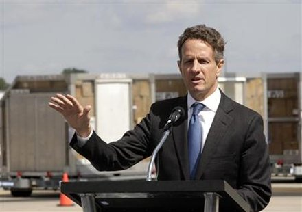 Treasury Secretary Geithner addresses members of media about President Obama's jobs bill during a tour of UPS' World Port air hub in Louisvi