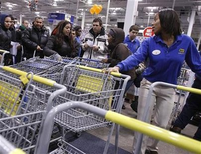 People reach for shopping carts during Black Friday sales at the Best Buy electronics store in Westbury,New York