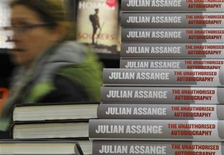 A woman passes a display of the unauthorised autobiography of WikiLeaks founder Julian Assange at a bookstore in central London