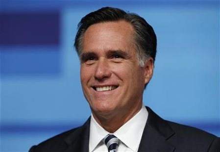 Former Massachusetts Governor Romney smiles before the start of the Republican Party of Florida presidential candidates debate in Orlando