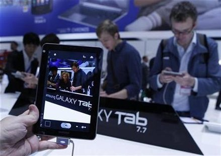 Man holds a Samsung Galaxy Tab 7.7 during press day at IFA consumer electronics fair in Berlin