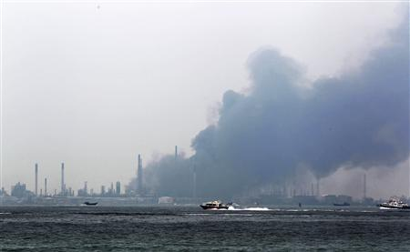 Smoke billows from Royal Dutch Shell's Pulau Bukom offshore petroleum complex in Singapore