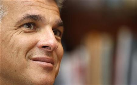 File photo of newly appointed Swiss bank UBS CEO Sergio Ermotti smiling during a Reuters interview in downtown Milan