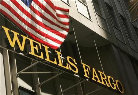 A U.S. flag flies above Wells Fargo & Co headquarters in San Francisco