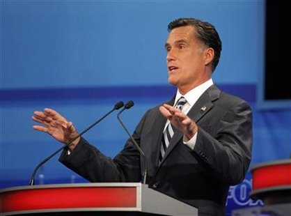 Former Massachusetts Governor Mitt Romney speaks during the Republican Party of Florida presidential candidates debate in Orlando