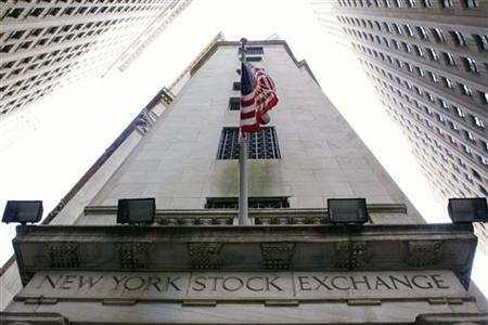 An U.S. flag hangs outside the New York Stock Exchange